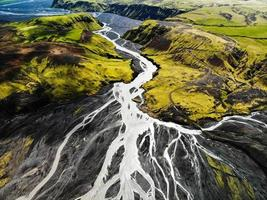 Aerial view of river flowing through mountains