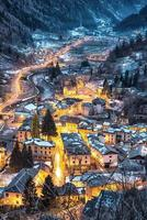 Nightime landscape scene of mountain town