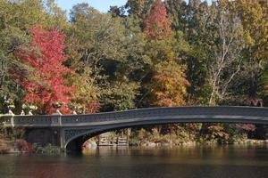 Bridge over river with colorful autumn trees  photo