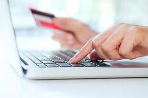 Close-up of person shopping online