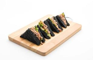 Tuna charcoal sandwiches on a wooden board