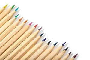 Wooden colored pencils on white background