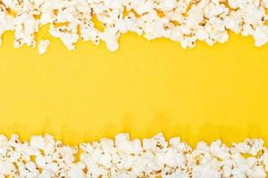 Top view of a popcorn border on a yellow background