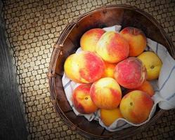 Fresh peaches in a bowl photo