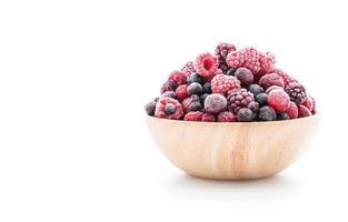 Frozen berries in wooden bowl