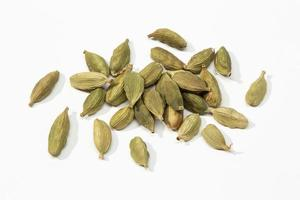Dried cardamom seeds on a white background photo