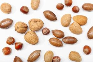 A variety of nuts on a white background
