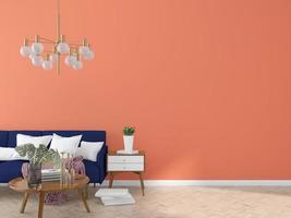 Blue sofa against orange wall