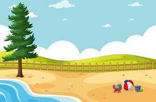 playa de arena con árboles cerca de colinas