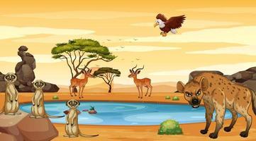escena con animales salvajes junto a un estanque.