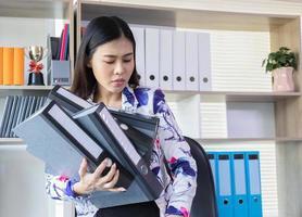 Businesswoman organizing office