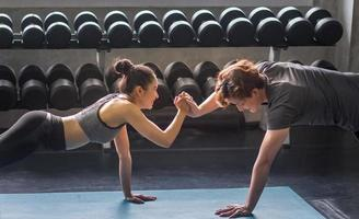 Woman and man working out in gym