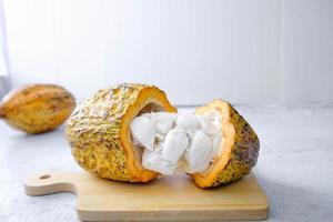 Fresh cocoa fruit cut in half