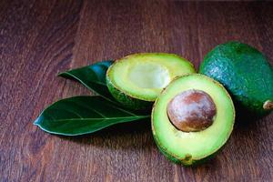 Ripe avocado fruits and leaves