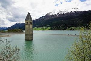 Church tower in Resia Lake photo