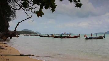 Coastal fishing boats floating; In stormy rains  in Phuket, Thailand.