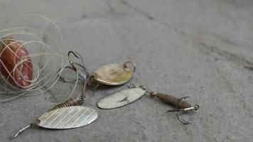 Old spinner bait and fishing reel. video