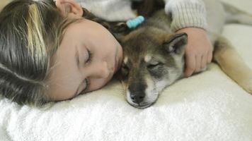 girl falls asleep hugging  puppy