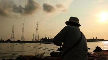 The fisherman has fished, silhouette