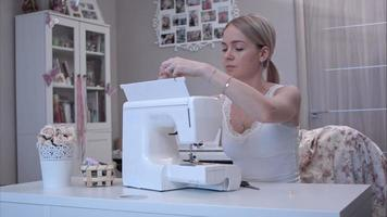 Young woman preparing her sewing machine video