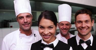Cheerful restaurant staff smiling at camera