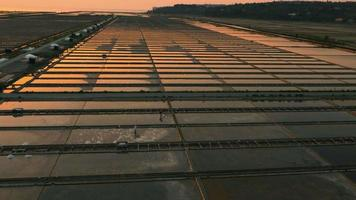 4K Aerial: Tracking Workers on Pans at Dusk