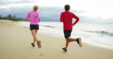 Couple Jogging Together on the Beach