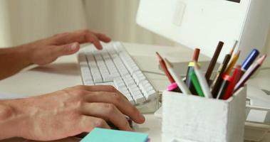 Man writing with keyboard in his computer