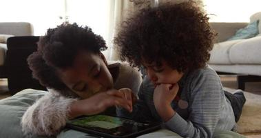 Two Children Playing With Digital Tablet At Home Shot On R3D