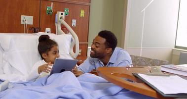 Father And Child Use Digital Tablet In Hospital Shot On R3D video