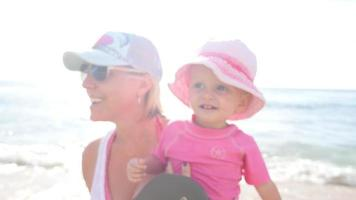 Blonde mother and baby on a beach video