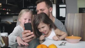 Man taking happy selfies with daughters video