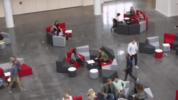 Overhead handheld shot of students in university lobby, shot on R3D