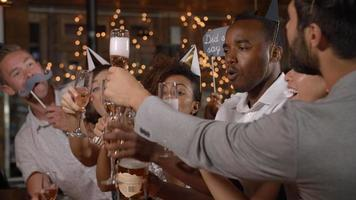 Friends making a toast with champagne at a New Year's party video