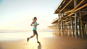 Woman Working out on Beach at Sunset. Fitness Active Lifestyle. Running on the Sand