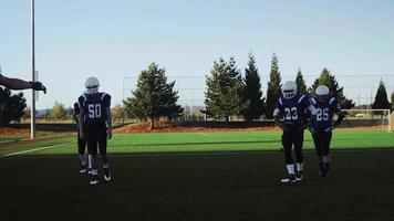 Football players warming up before a game video
