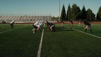 A football player gets the ball handed off to him and he runs toward the end zone video