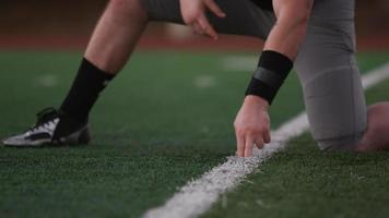Close up of a football player kicking the ball toward the goal posts video