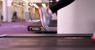 Super fit woman running on the treadmill