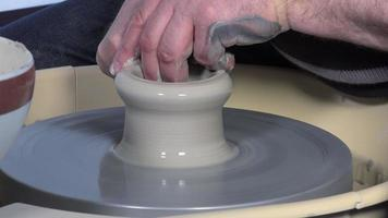 potter working with clay video
