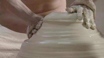 Hands working on pottery wheel, shaping a ceramics video