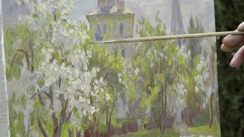 imagem do conceito e escova. artista habilidoso desenha pinturas de macieiras em flor