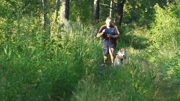 man running with a dog Husky