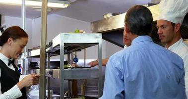 Employer looking at chefs taking orders video