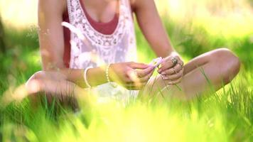 Hippie teenager holding flower in a summer park video