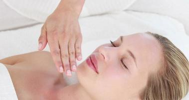 Calm woman receiving reiki treatment video