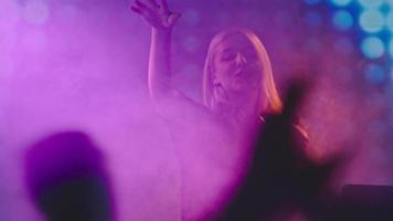 Blond DJ Woman Performing on Concert video