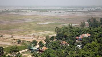 flooded paddy fields and quiet life in a village in the foreground