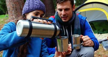 Hiker woman serving coffee to her husband video