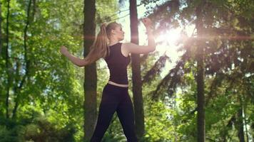 Woman stretching in park at evening. Young female runner warm up outdoor